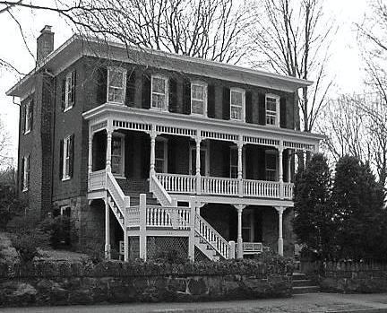 Black and white photo of a 3 story 1867 House