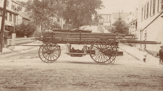 Wooden handcart in a sepia tone photo