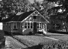 a black and white photo of a house
