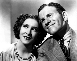 George Burns and Gracie Allen smiling together