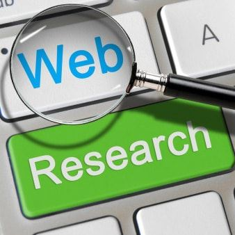web research button on keyboard and magnifying glass