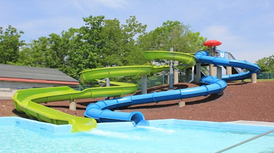 one blue water slide and one green water slide