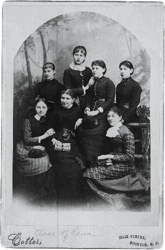 black and white photo of a group of girls in black dresses