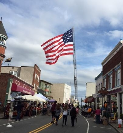Flag waving Proudly over main street